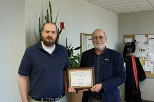 Professor Ethan Amidon being awarded by Gary Rader