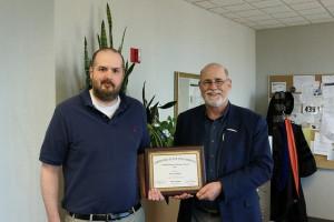 Professor Ethan Amidon being awarded by Gary Rader