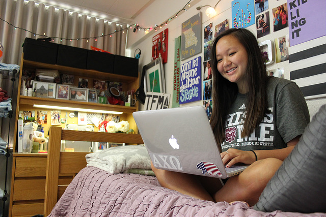 online student studies in her residence hall room.