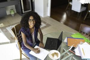 Teenage girl studies at home