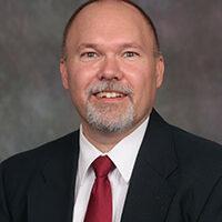 Professional headshot of Dr. Ken Brown.