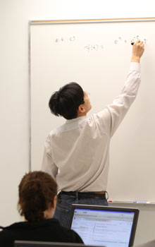 Professor at white board