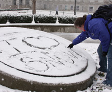 """""""I heart snow"""" written in the snow on the University seal"""
