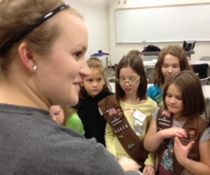Jen Kienstra with Girl Scout Brownies
