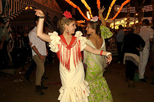 Adria Baebler and her host mom Teresa perform a traditional Sevillana dance during Feria.