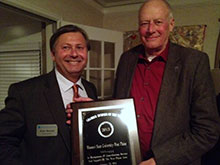 Drew Bennett accepts Business of the Year award for West Plains campus