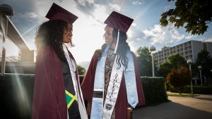 Female students in graduation gowns