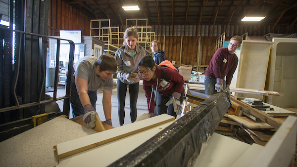 Students work at Habitat for Humanity