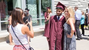 Graduate poses for picture