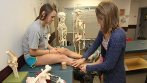 Athletic training student wraps ankle