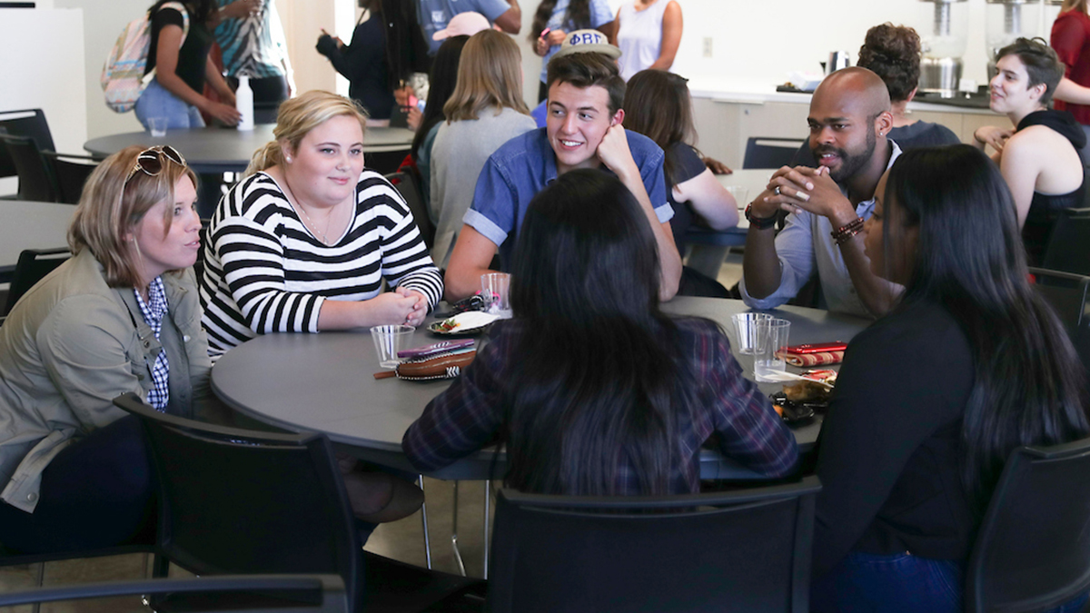 Staff and students at roundtable