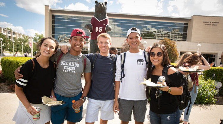 Students pose with tamales at 2018 Latinx Heritage Month Kickoff