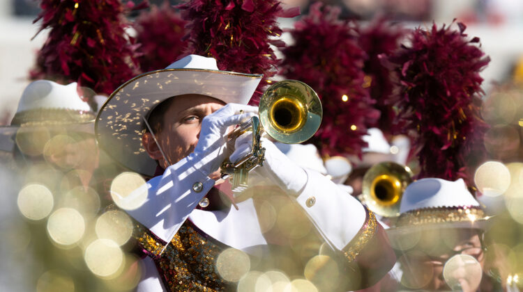 Trumpeter performs at football game