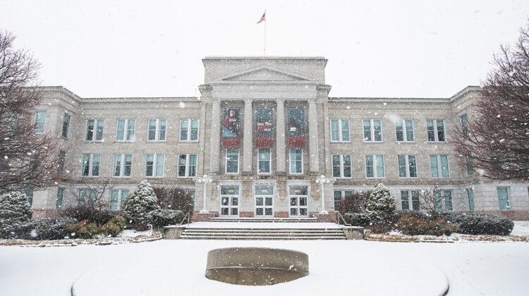 Snow falls on Carrington Hall