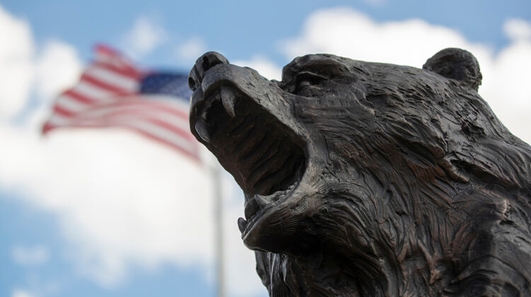 Bear statue by American flag