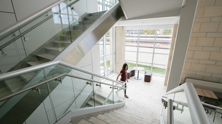 Student walking up stairwell in Magers Health and Wellness Center.