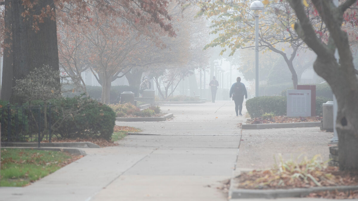 Empty sidewalks on a fall, foggy morning on campus.