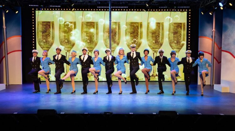 """Dancers perform on Tent Theatre's stage during 2019's """"Catch Me if You Can."""""""