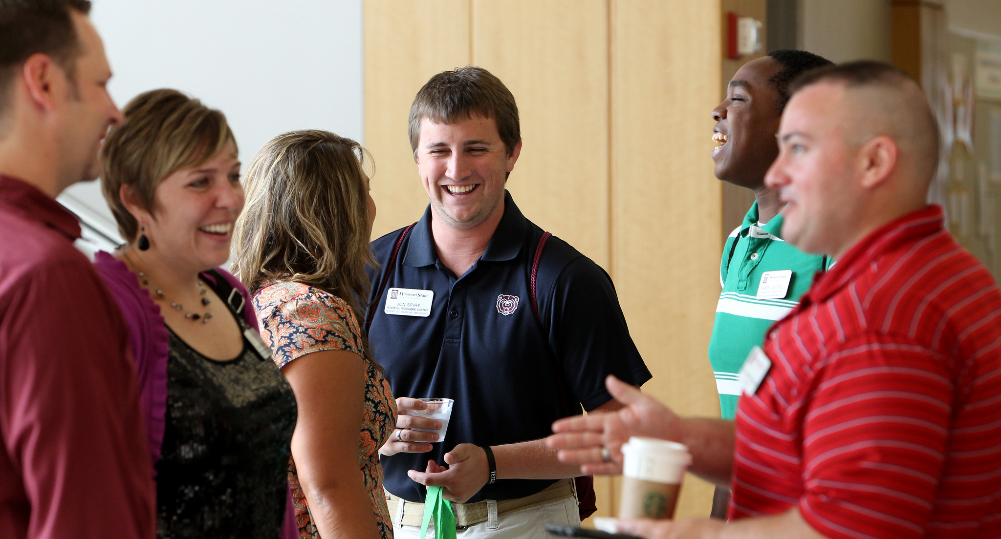 faculty talking with each other in a social setting