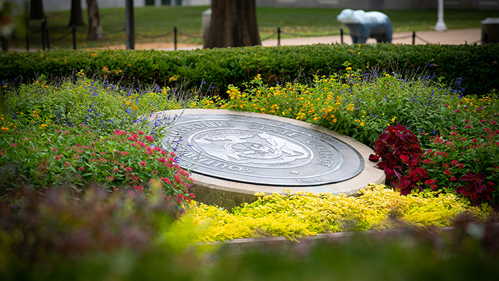 flowers around the seal in front of Carrington Hall