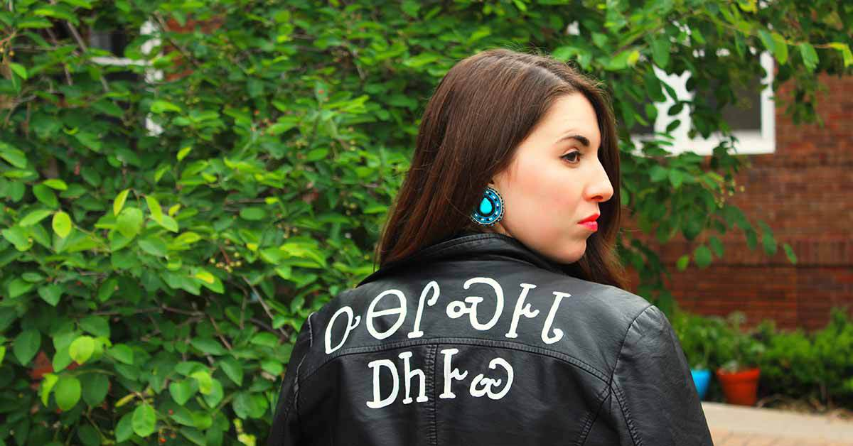 Kirby Williams wearing leather jacket with Native American messaging.