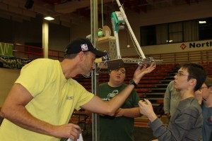 Brian and students working on their robot the day before the competition.
