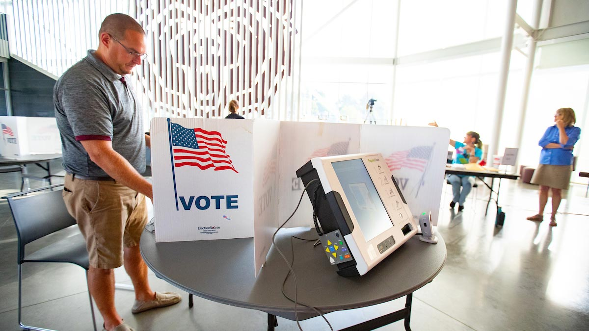 A man votes at the Welcome Center