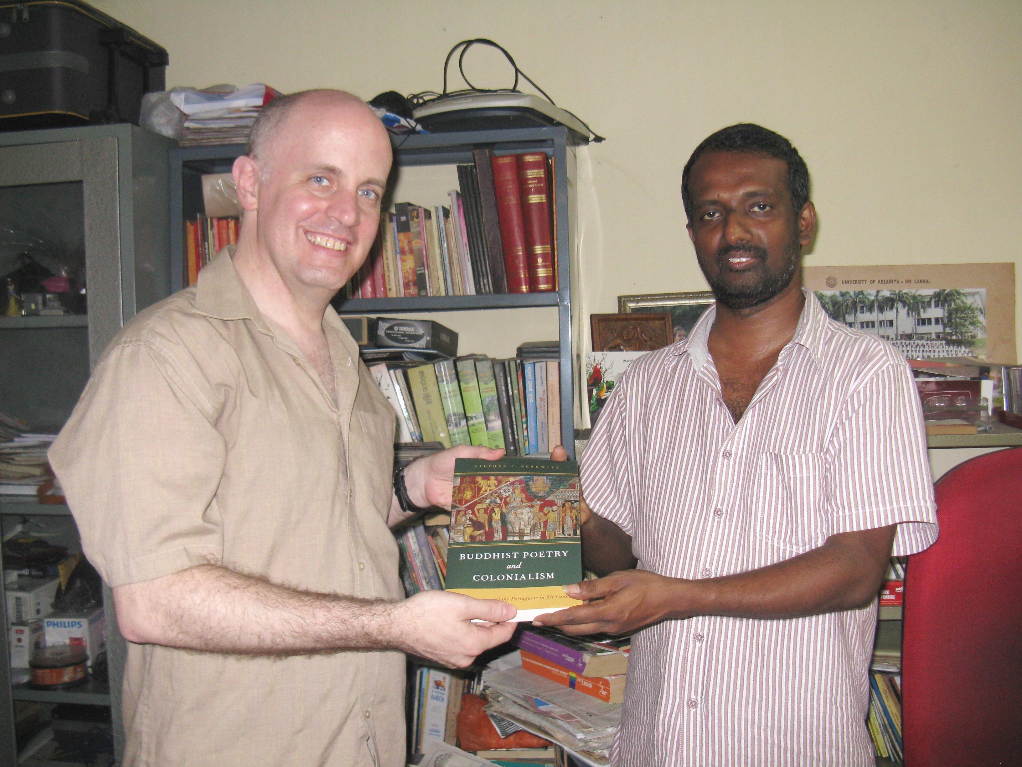 REL Professor Presents Book to Poet's Descendent