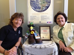 "Religious Studies senior instructor Lora Hobbs (left) and Public Affairs Support director Mary Ann Wood (right) received the ""Woo Hoo Huey"" award for their fall 2014 ""Stomp Out Hunger"" project!"