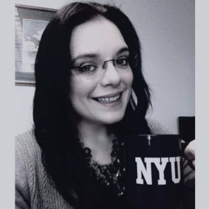 Religious Studies M.A. student Sarah Riccardi with her NYU mug!