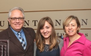 Samantha Nichols, center, with her parents, Joel and Jessica Nichols
