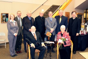 Drs. Stan and Ruth Burgess (seated), with, from left: Dr. Lois Olena of AGTS' Dr. Eric Newberg; Dr. Byron Klaus (president of AGTS); Fr. Leibrecht (fourth from left), formerly Bishop of the Springfield-Cape Girardeau diocese; Dr. Victor Matthews (fifth from left), Dean of MSU's College of Humanities and Public Affairs and Professor of Religious Studies at MSU; Brad Burgess (son of Stan and Ruth); and Dr. Paul Lewis (AGTS)