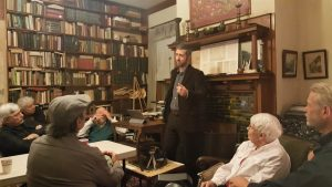 Photo of Religious Studies Assistant Professor, Dr. Vadim Putzu, speaking to visitors at the Johnson Library