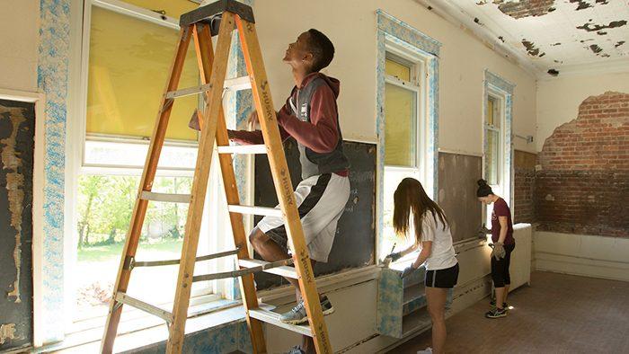 students clean fairbanks school