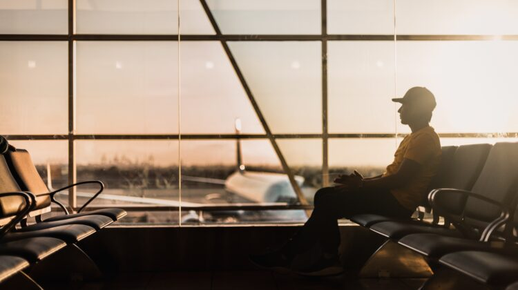 Man sitting alone in terminal