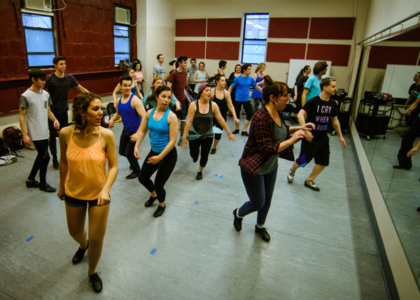 Alumnus Mark Albrecht teaches students and alumni tap techniques in a New York workshop.