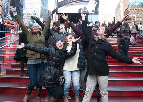 Students pose at New York City's iconic Times Square TKTS pavilion.