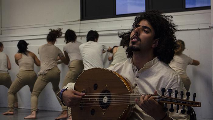 "Musician Omar Vinaty and Missouri State dancers rehearsing ""Hunak"""