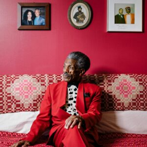 André de Shields sits on a couch in his apartment (Photo Credit: Axel Depeux)
