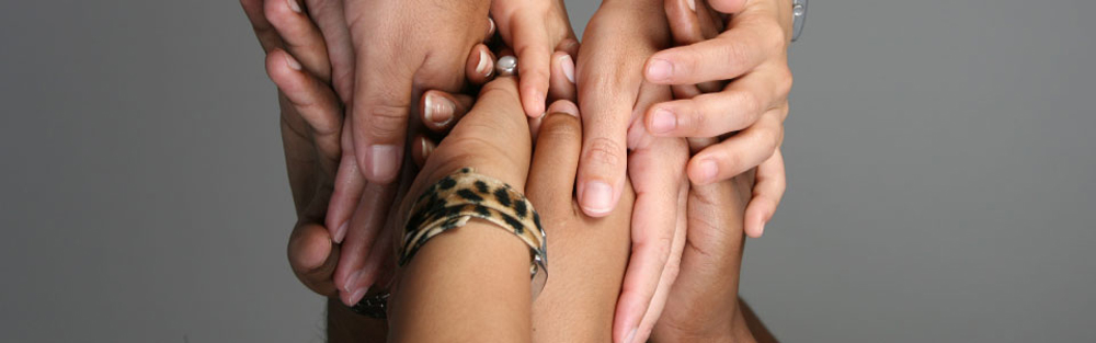 Hands reaching out; promotional photo for the Statewide Collaborative Diversity Conference