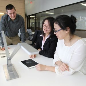 Students viewing an iPad