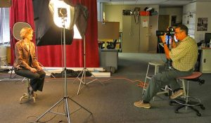 Faculty member being photographed during Free Portrait Days