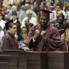Graduate celebrating at commencement