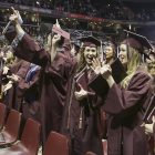 Graduates clapping and celebrating