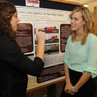Two students discussing presentation at Graduate Interdisciplinary Forum