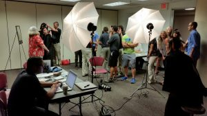 Faculty and staff participating in a Free Portrait Day