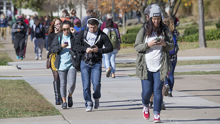Campus scene with many students on mobile phones
