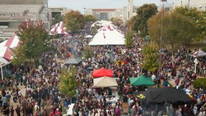view of crowd and tents at Bearfest Village