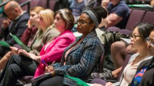 community members listen to a public affairs lecture