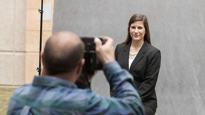 photographer takes headshot of student